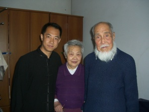 Shang Ji with student and wife