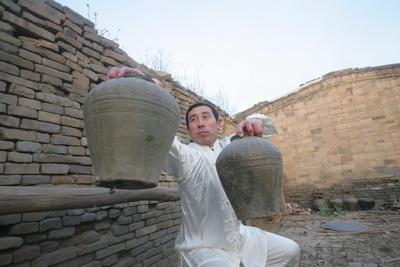 Grabbing clay jars