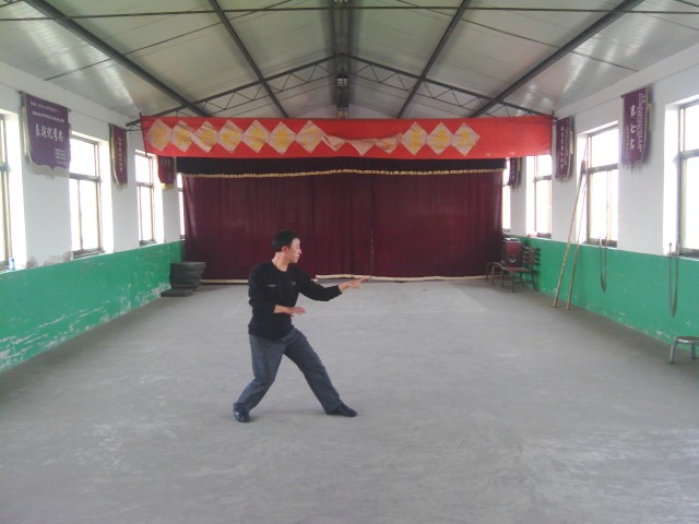 Zhao Chuanhui strikes Santi pose in his wuguan